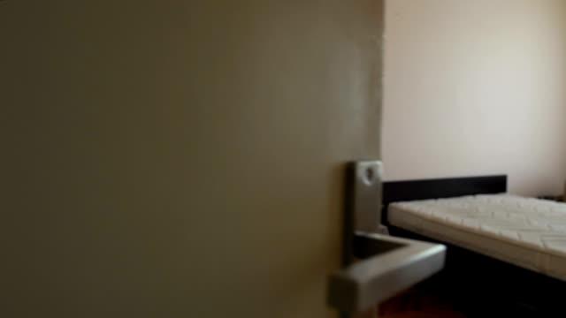 vídeos de stock e filmes b-roll de small modestly furnished rented room in hostel, cheap accommodation, motel - sem higiene