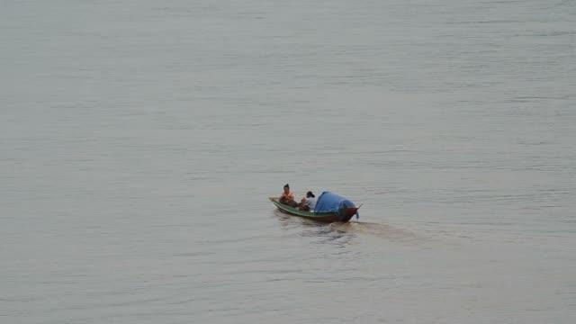 small motor boat across Mekong river video