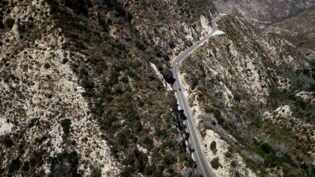 Small Mountain Road Snaking Through Dry Rugged Landscape video