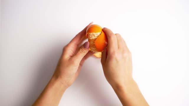 Small orange citrus in hands.