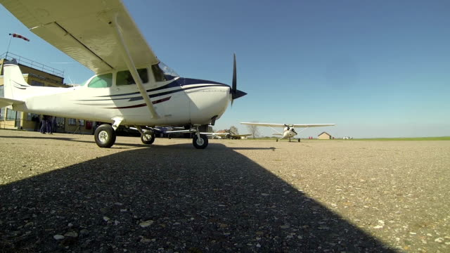 Small Plane at the Airport Small plane for pilot training ready to take off. propeller airplane stock videos & royalty-free footage