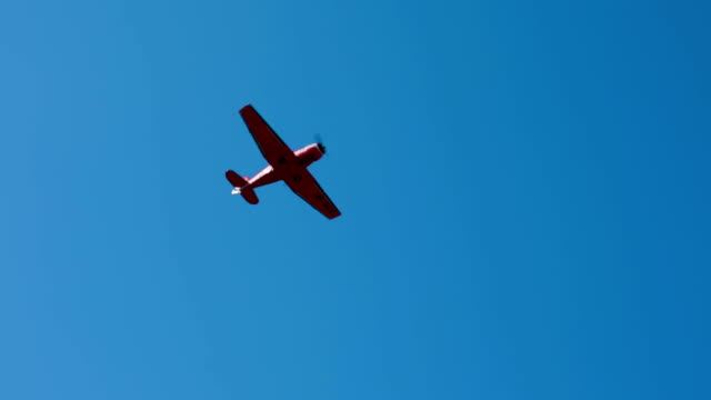 Small Plane Flying In Blue Sky Camera is following a small plane flying in a crystal blue sky. propeller airplane stock videos & royalty-free footage