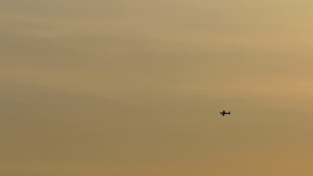 Small Plane Flying in Sunset video
