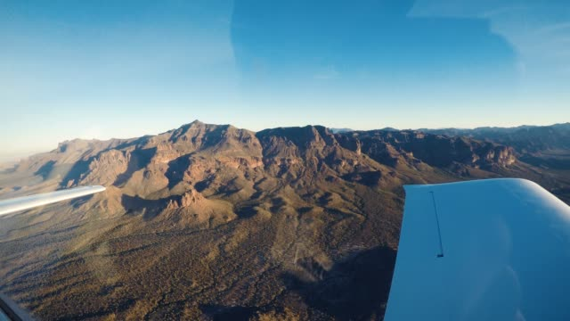 Small Plane Wing View of Superstion Mountains in Tonto National Forest Breathtaking landscape perspective from two seat propeller plane of famous mountain range near Phoenix Arizona propeller stock videos & royalty-free footage