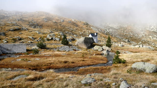 Small Pump House in Pyrenees high Mountain Landscape in Autumn fog Dam and Pump house in Saboredo, Lérida, Pyrenees lleida stock videos & royalty-free footage