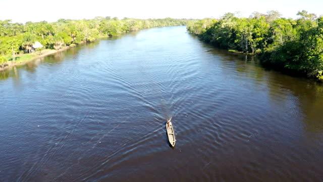 small river skiff, black water tributary of the amazon river, peruvian amazon, peru video