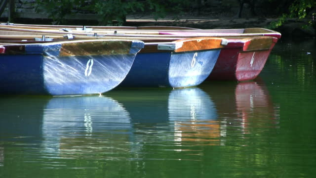 Small rowing boats floating on lake, peaceful, HD video