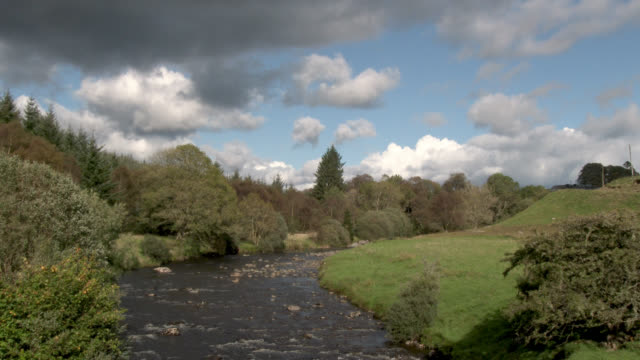Small Scottish river 4k footage shot at 50fps and interpreted at 25fps to give slower motion dumfries and galloway stock videos & royalty-free footage