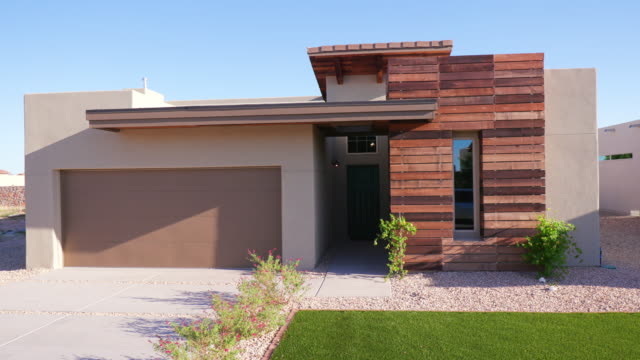Small Southwest Modern Home Exterior Rise and Lower shot of a small exterior southwest home rising and lowering from straight on the front angle facade stock videos & royalty-free footage