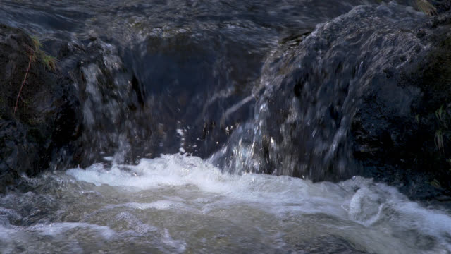 Small stream in rural Scotland 4K footage shot at 50fps and interpreted at 25fps to give a slow motion running water stock videos & royalty-free footage
