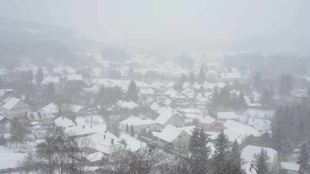 A small town during heavy snow fall (Bakonybel Hungary) Winter in Bakonybel, a small touristic town located in the Bakony mountain range in Hungary (2021 January) hungary stock videos & royalty-free footage