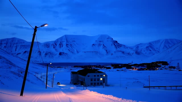 A small town in the far north of Europe among the snow-capped mountains at night. Longyearbyen, Spitsbergen. video