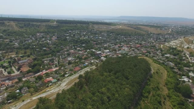 AERIAL: Small town in valley between canyons video