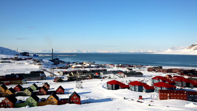 Small town Longyearbyen on the shores of the Arctic Ocean among snow-capped mountains of the Norwegian archipelago of Svalbard. video