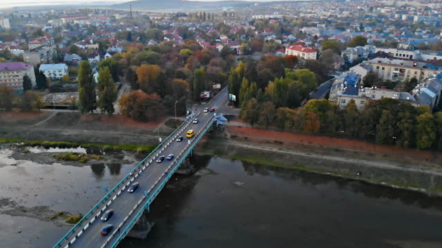 small town panoramic view from above in the autumn over the uzh river during the sunset uzhhorod ukraine europe - transcarpazia video stock e b–roll