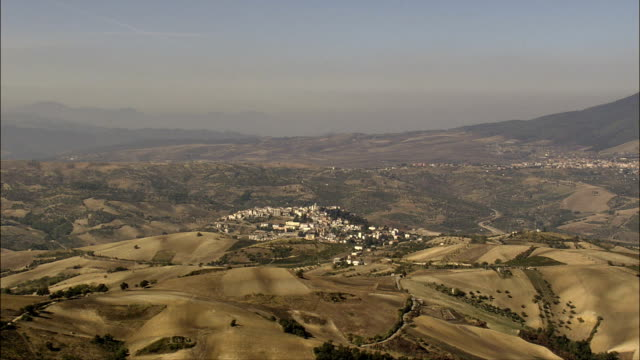 Small Towns Surrounded By Dry Farmland  - Aerial View - Basilicate, Provincia di Potenza, Venosa, Italy video