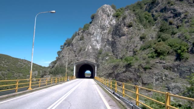 Small tunnel on a mountainous country road in northern Greece