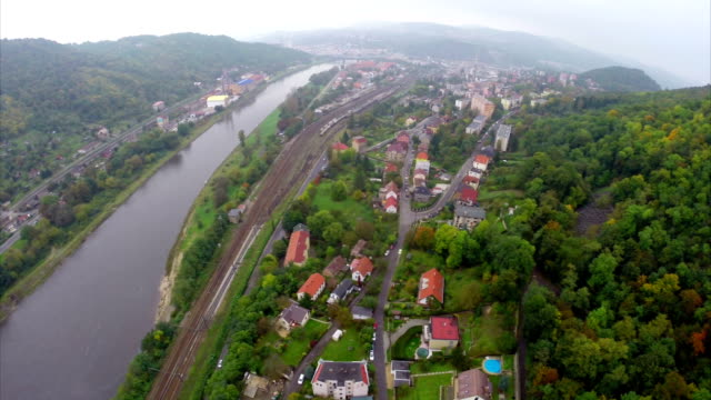 Small village along river mountains in valley, clouds fog autumn. Beautiful aerial shot above Europe, culture and landscapes, camera pan dolly in the air. Drone flying above European land. Traveling sightseeing, tourist views of Czech Republic. Small village along river mountains in valley, clouds fog autumn. Beautiful aerial shot above Europe, culture and landscapes, camera pan dolly in the air. Drone flying above European land. Traveling sightseeing, tourist views of Czech Republic. arthropod stock videos & royalty-free footage