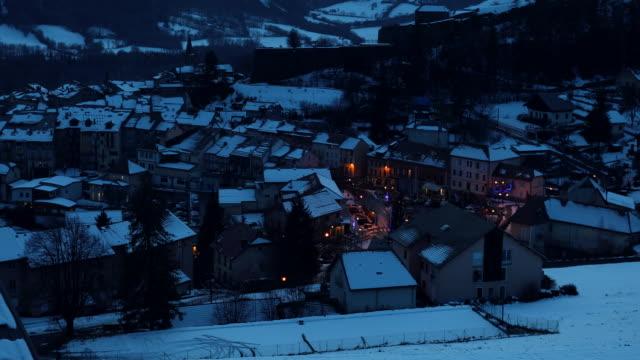 vídeos de stock e filmes b-roll de small village in winter at night - aerial view - altos alpes