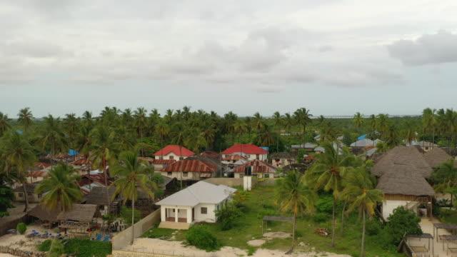 AERIAL Small village on Zanzibar. Pingwe village. Drone shot of a small village on Zanzibar. Tanzania. tanzania stock videos & royalty-free footage
