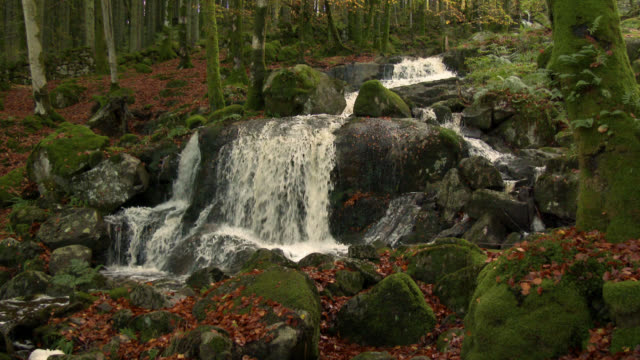 Small waterfall in rural Scotland 4K footage shot at 50fps and interpreted at 25fps to give a slow motion running water stock videos & royalty-free footage