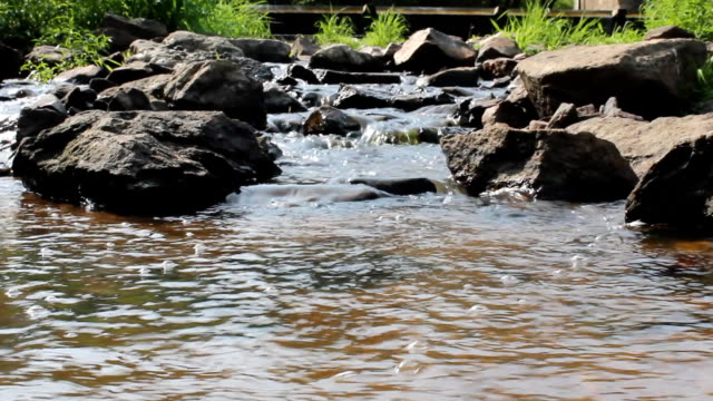 Small weir on stones with water video