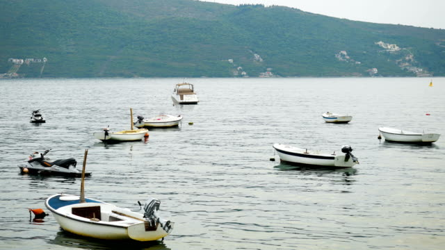 small white motor boats in the Bay in Montenegro video