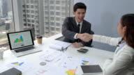 istock Smart Asian businessman making handshake 1179493181
