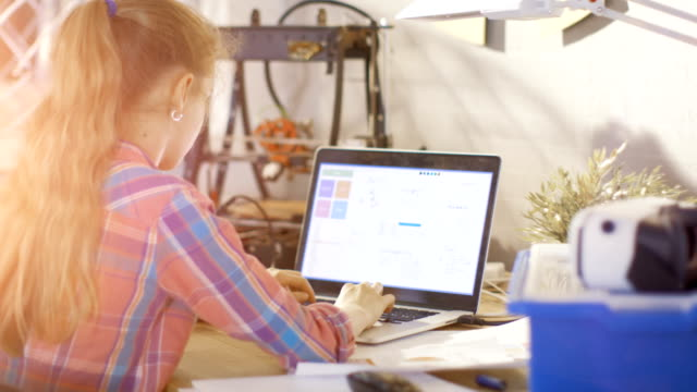 Smart Girl Work on a Laptop For Her Science Class School Project. video