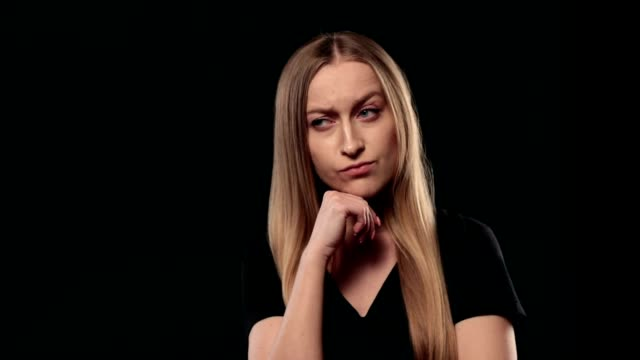 Smart minded woman with raised finger having idea video