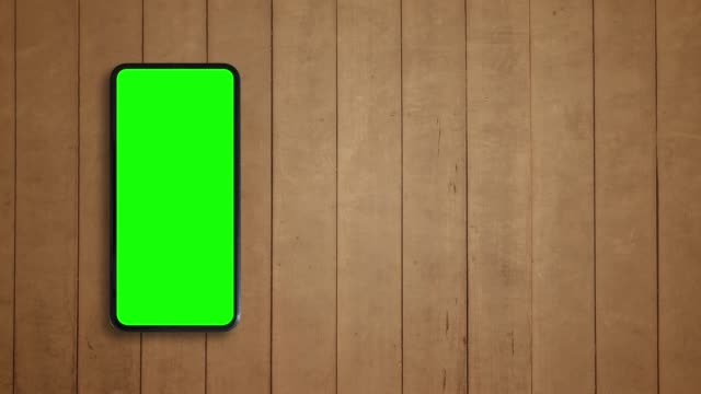 Smart phone green screen and wood texture background