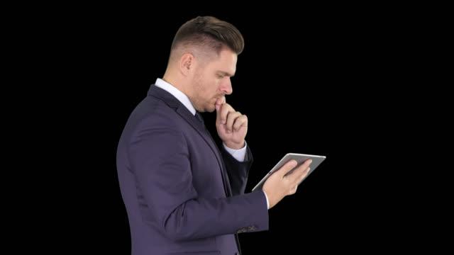 Smart senior businessman using a technology tablet, Alpha Channel
