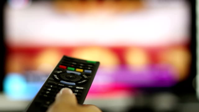 Smart tv and hand pressing remote control, time lapse video