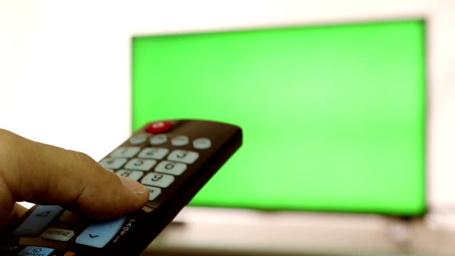 Smart tv and man pressing remote control with follow focus, Green screen video