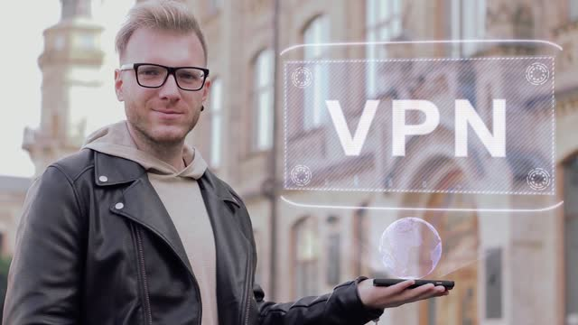 Smart young man shows hologram VPN
