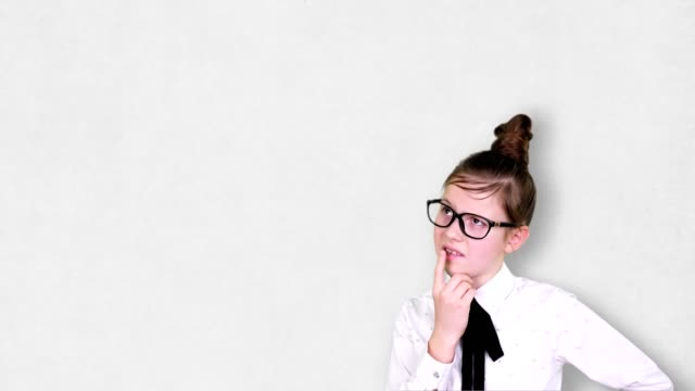 Smart Young Teenager girl ponders, comes up with a successful idea. Imagination, Education, start up and business idea concept - vídeo