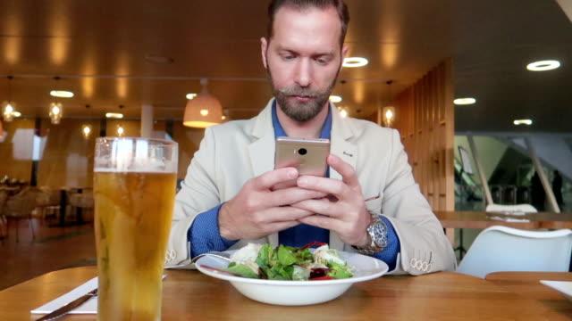 Smartphone addicted businessman - Stock Video