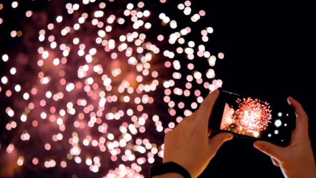 Smartphone and fireworks. RT CS 4K Smartphone and fireworks. fireworks videos stock videos & royalty-free footage