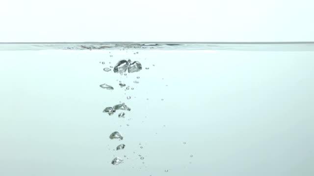stockvideo's en b-roll-footage met smartphone viel in het water, telefoon reparatieservice voor doorweekt telefoons, close-up - cell phone toilet