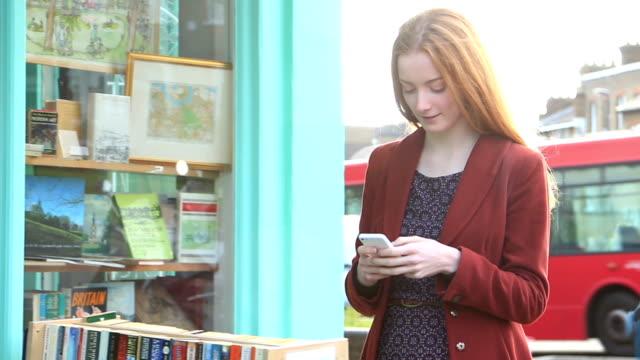 Smartphone girl outdoors.