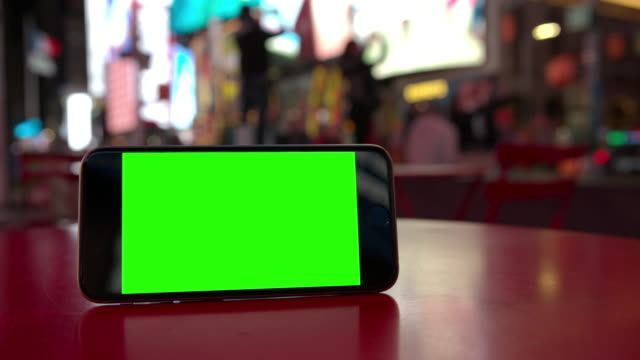 Smartphone mobile Time Square people green screen chromakey crowd NYC video