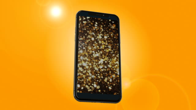 smartphone playing golden particles