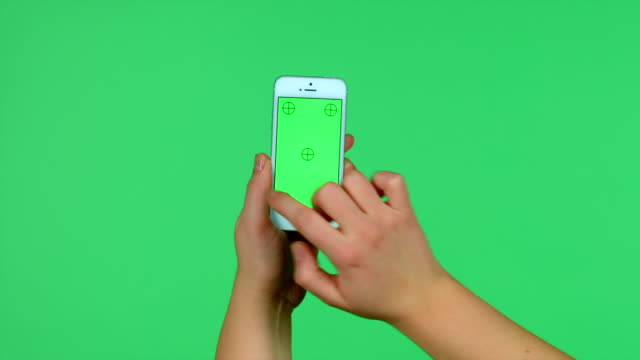 Smartphone tap, swipe, spread, pinch hand gestures on green screen video