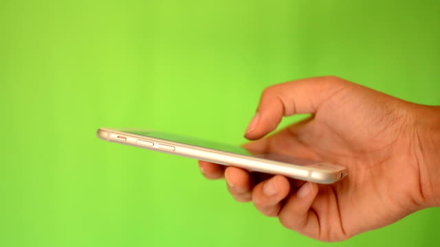 Smartphone touchscreen on green screen video