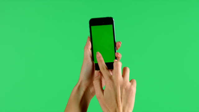 Smartphone touchscreen tap, swipe and spread hand gestures on green screen video