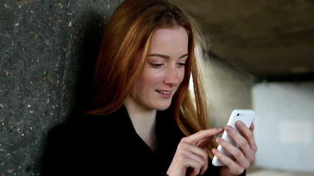 Smartphone urban girl. Red hair. video