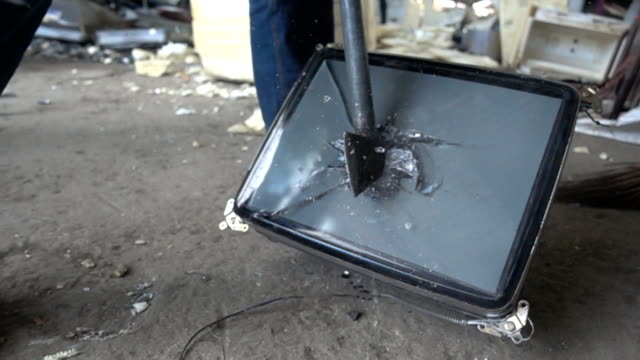 Smashing TV with hammer slow motion video