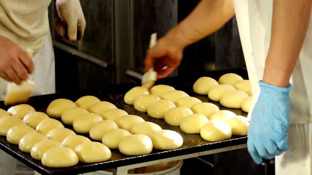 Smearing buns with glaze video