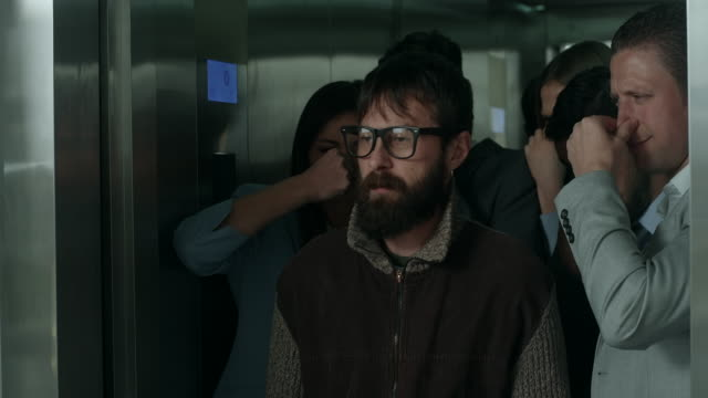 Smelly man in an elevator video