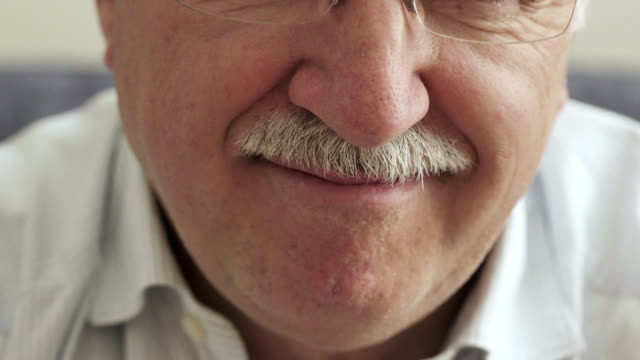 smile of elderly man with a mustache video